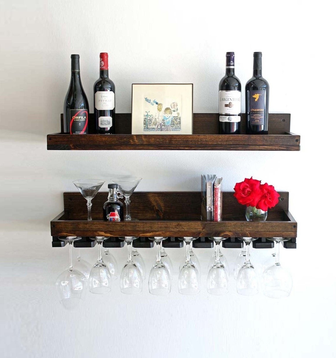 One rack that's a simple shelf on the wall and another rack that's a shelf with nooks for hanging wine glasses upside down