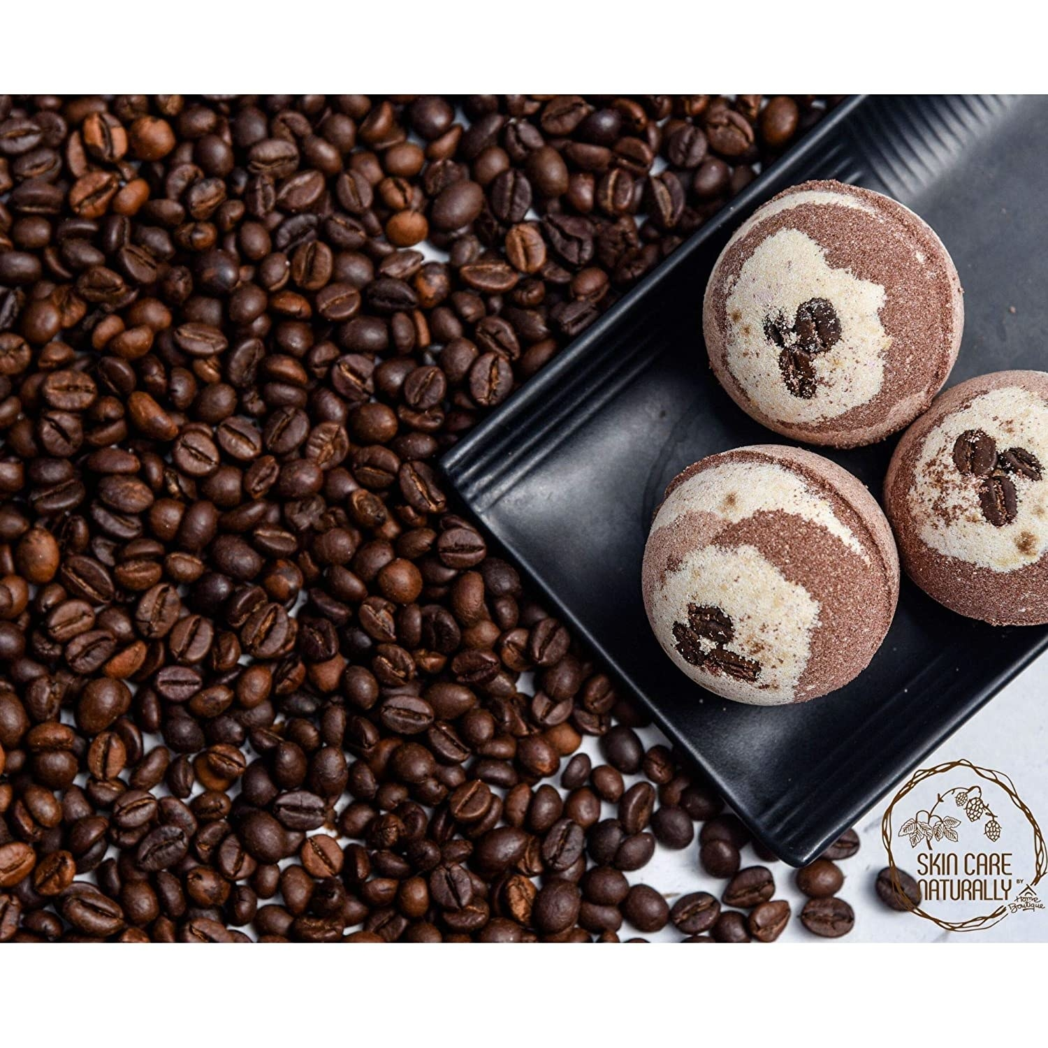 Coffee bath bombs and a pile of coffee beans on the side.
