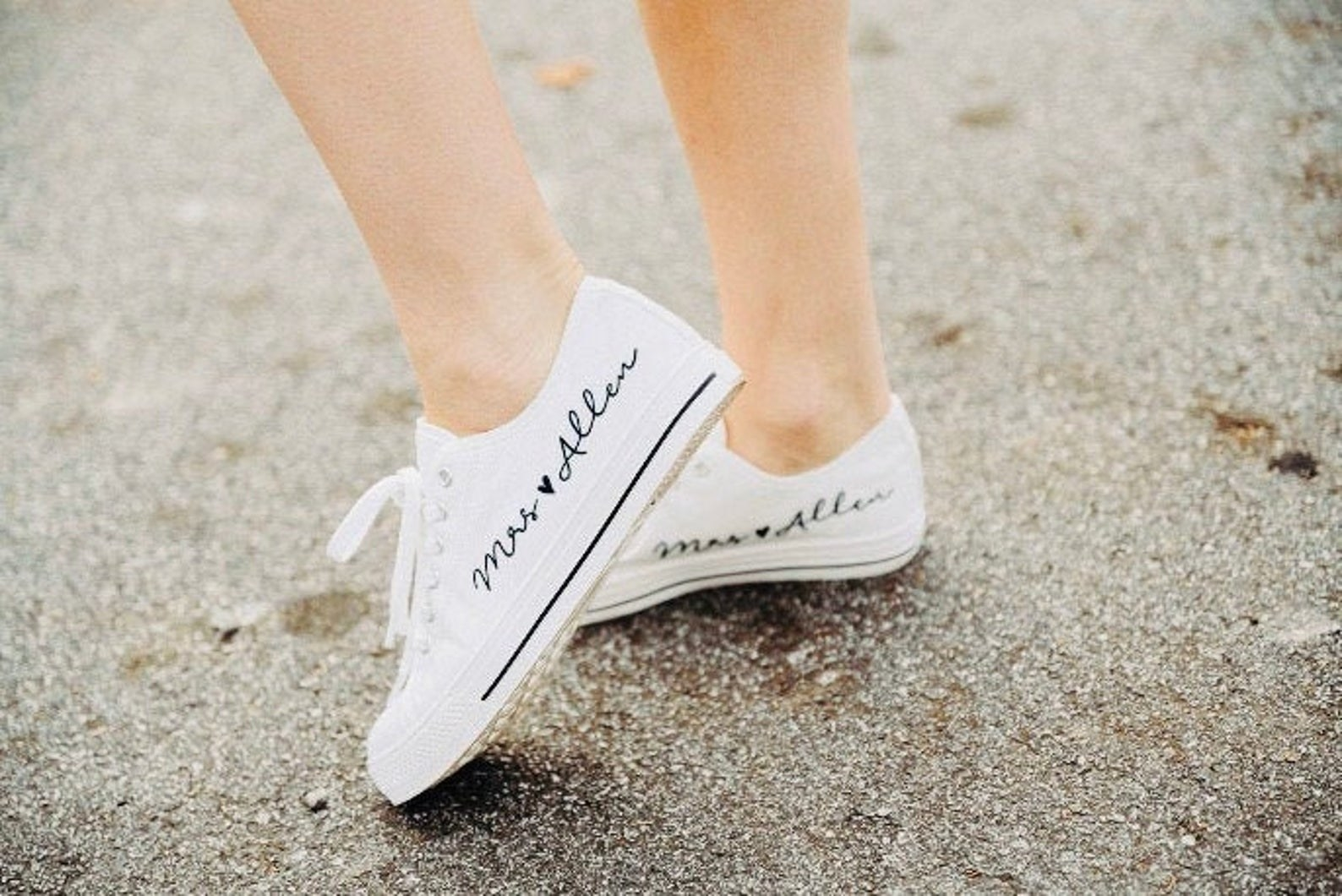 """All-white canvas sneakers with """"Mrs. Allen"""" written in script on the side"""