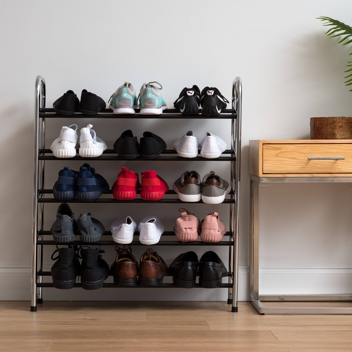 tennis shoes on a metal shoe rack