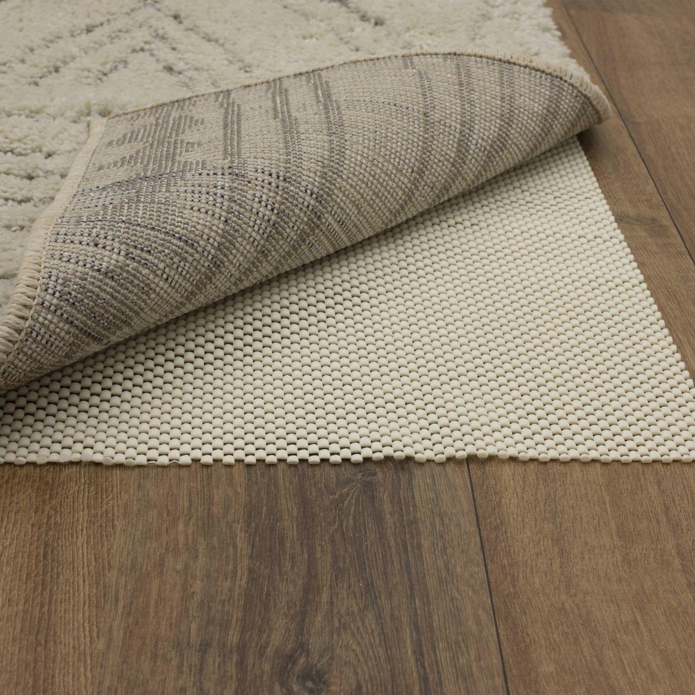 gripping rug pad underneath an area rug