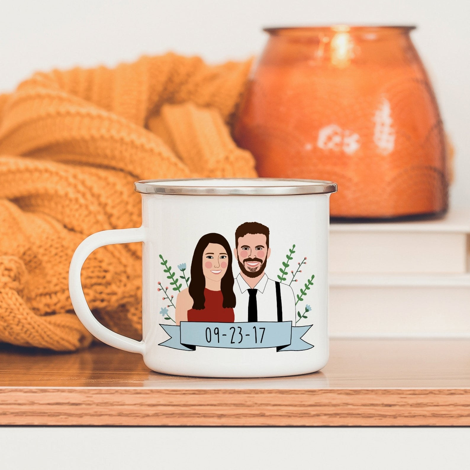 A white mug with an illustration of two people and a wedding date