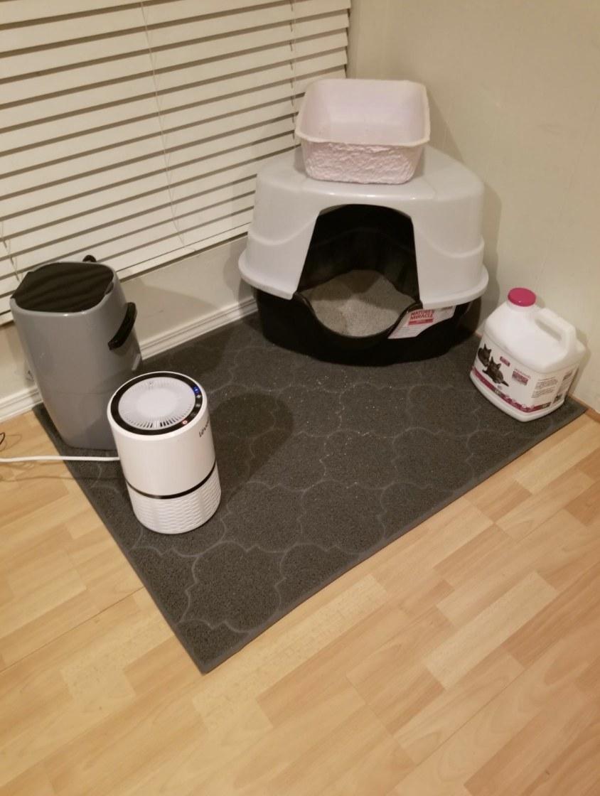 The large, gray cat litter mat