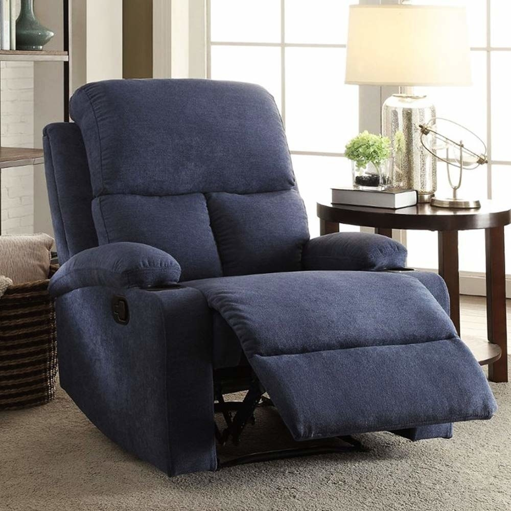 A blue recliner with a coffee table on one end and a towel basket on the other.