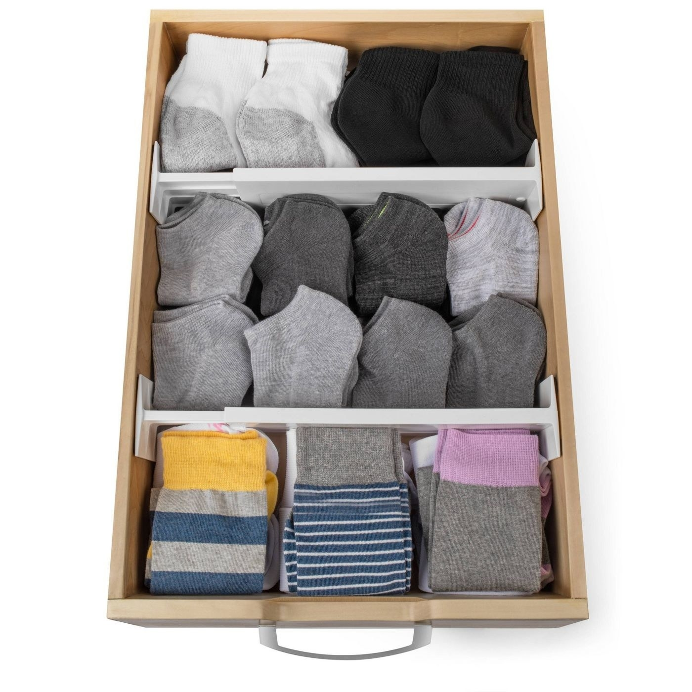 a top view of a drawer with two drawer organizers in them