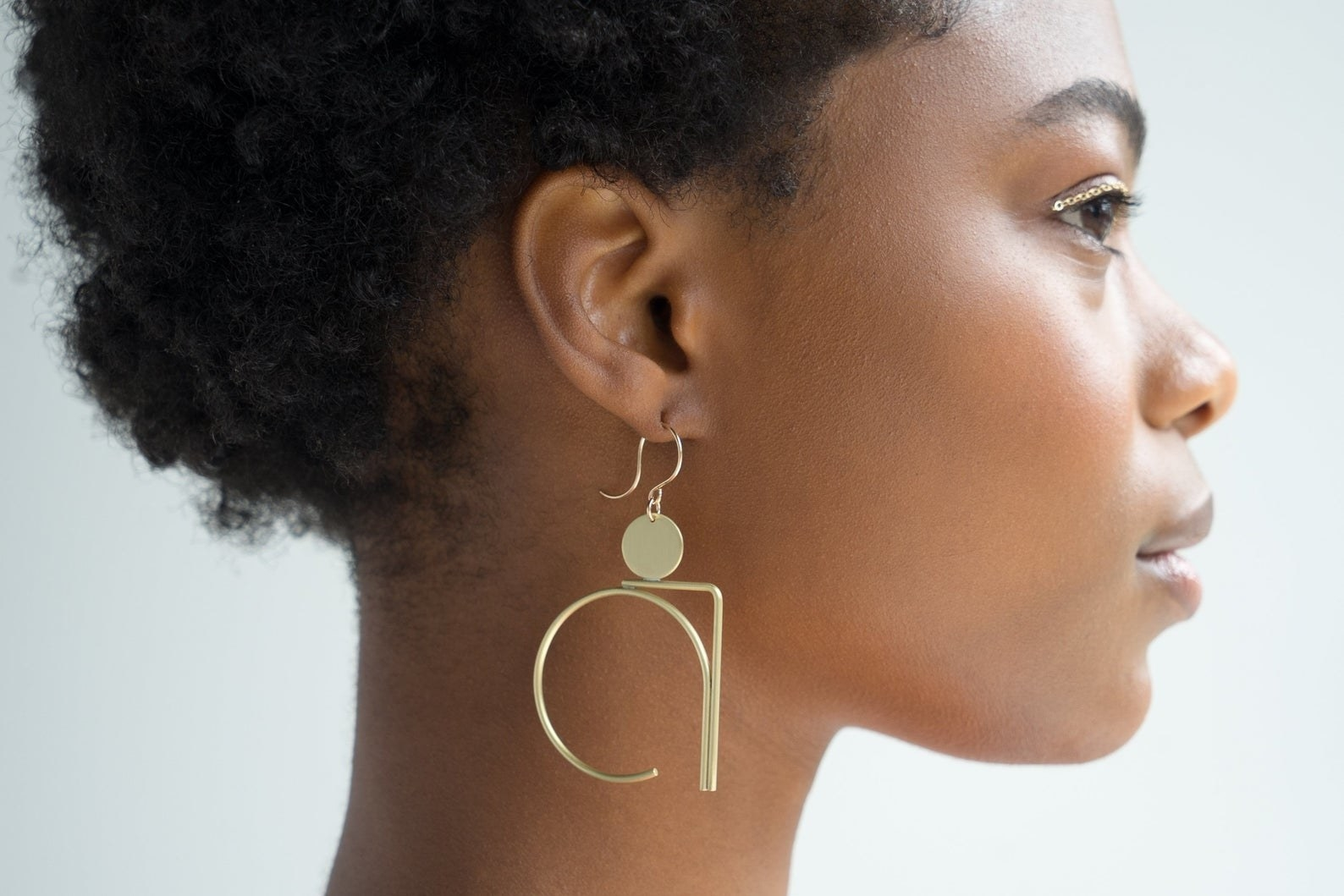The dangle earrings with circular and L-shaped designs