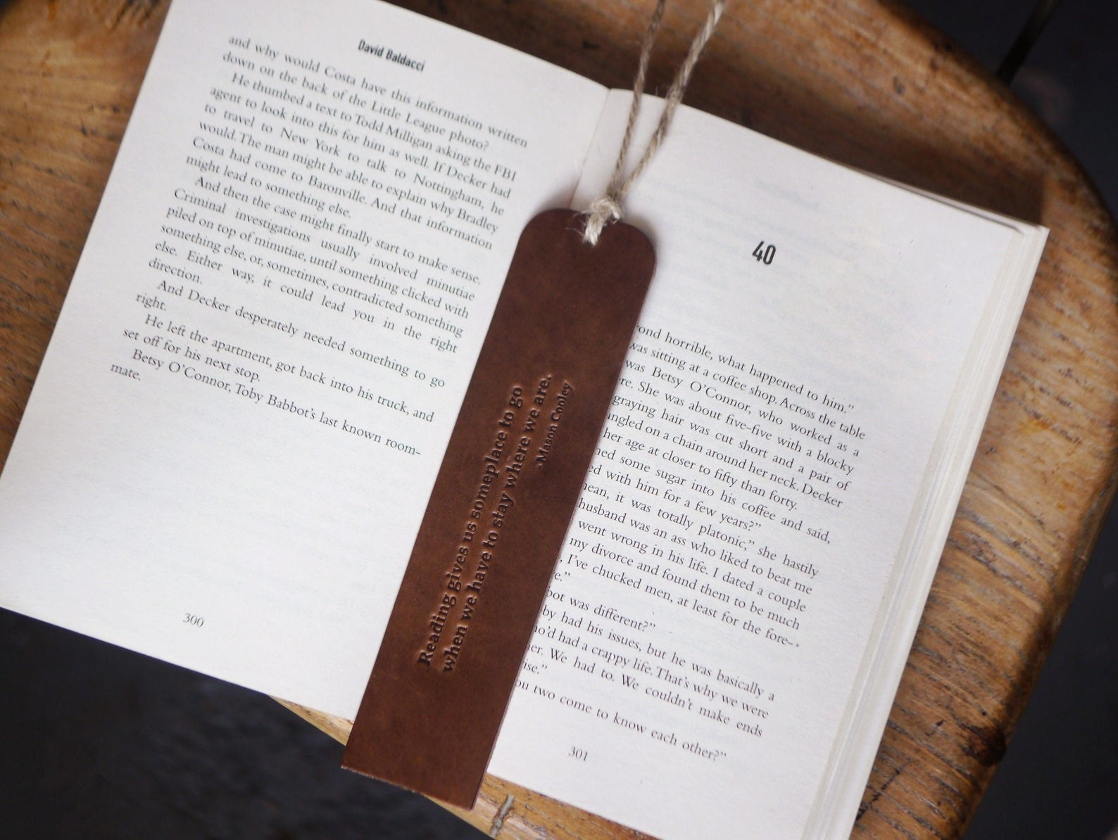 A brown leather bookmark in between pages of a book