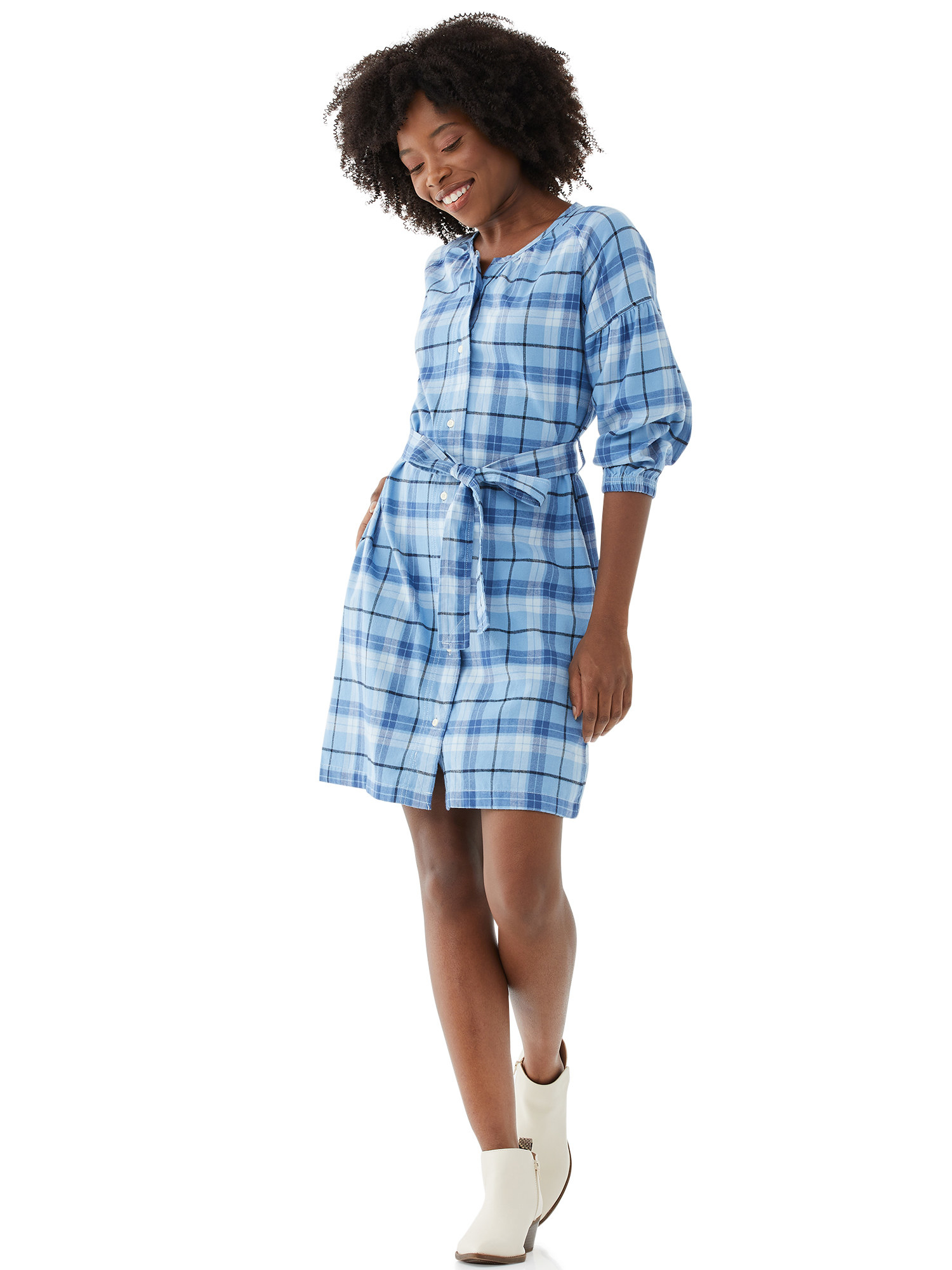 Model wearing white booties and a blue plaid dress