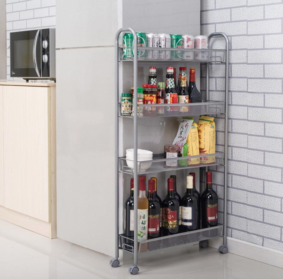 The rolling cart holding wine, soft drinks, and pantry items