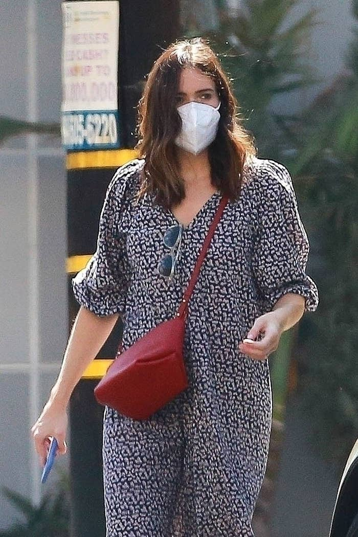 Mandy Moore shows off her growing baby bump on Saturday afternoon