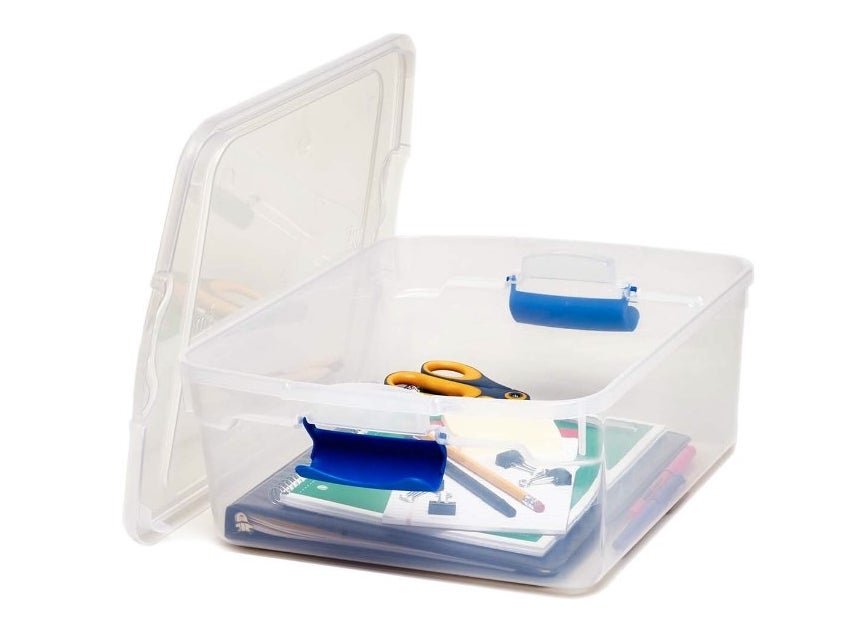 The storage bin being used to hold school supplies