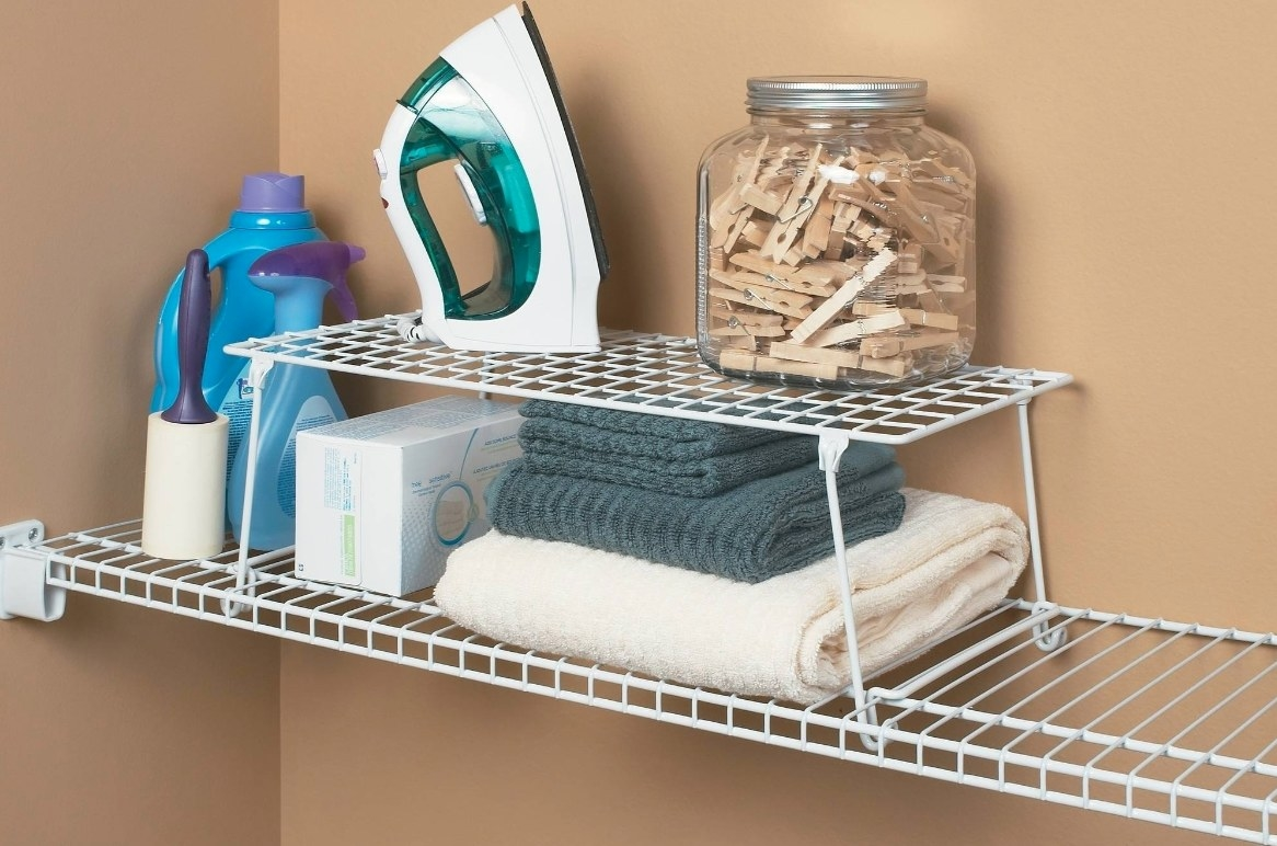 The white rack being used to hold laundry products