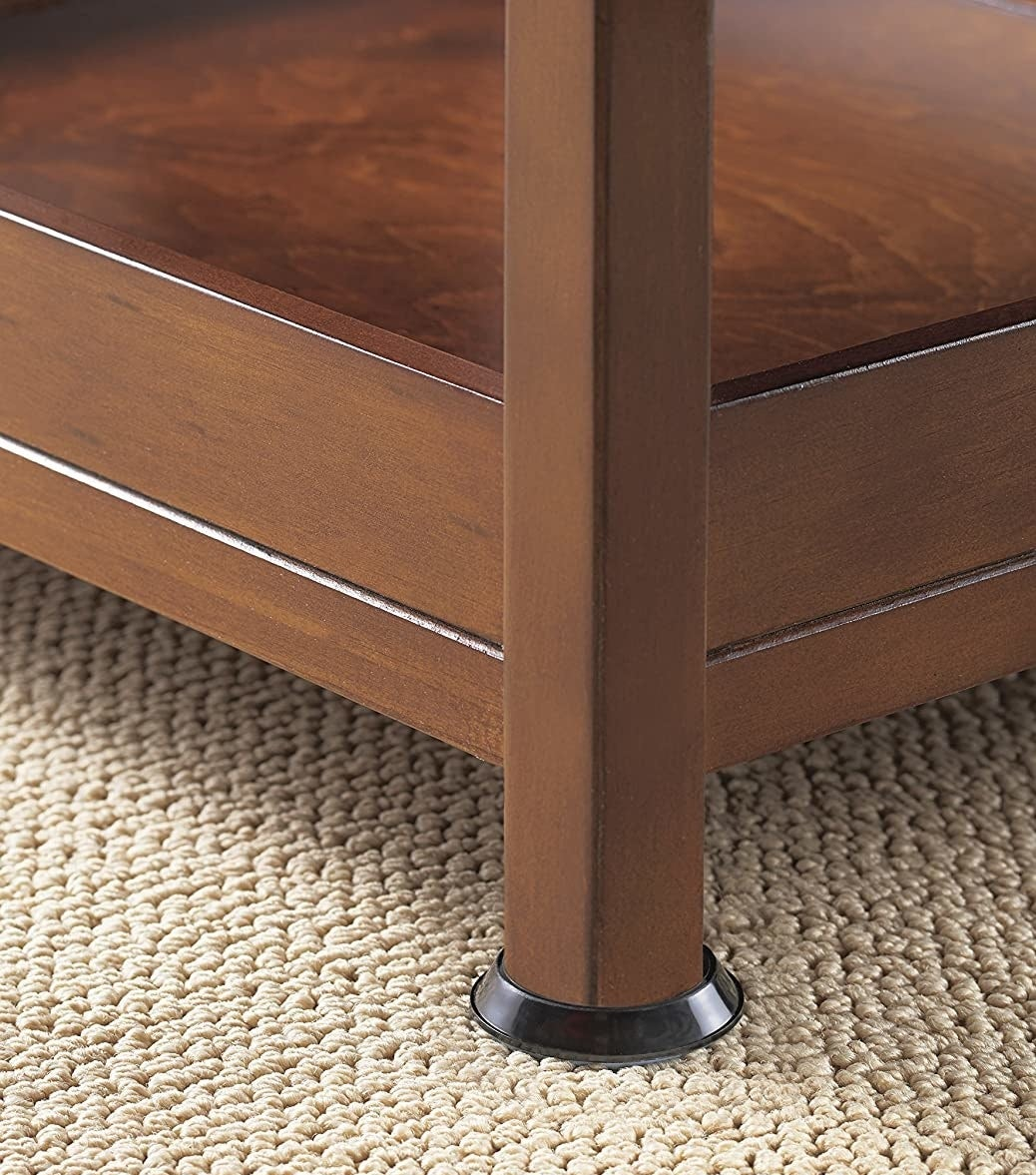 The sliders on the bottom of a table leg