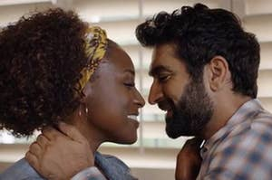 "Kumail Nanjiani and Issa Rae smiling at each other in ""Lovebirds"""