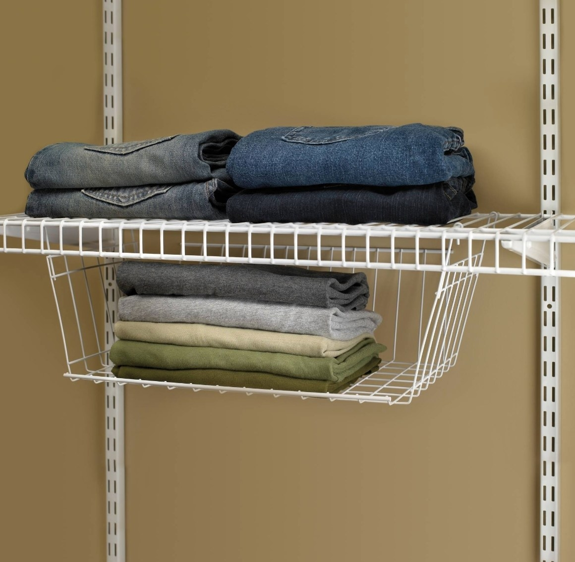 The white hanging basket being used to hold jeans and scarves