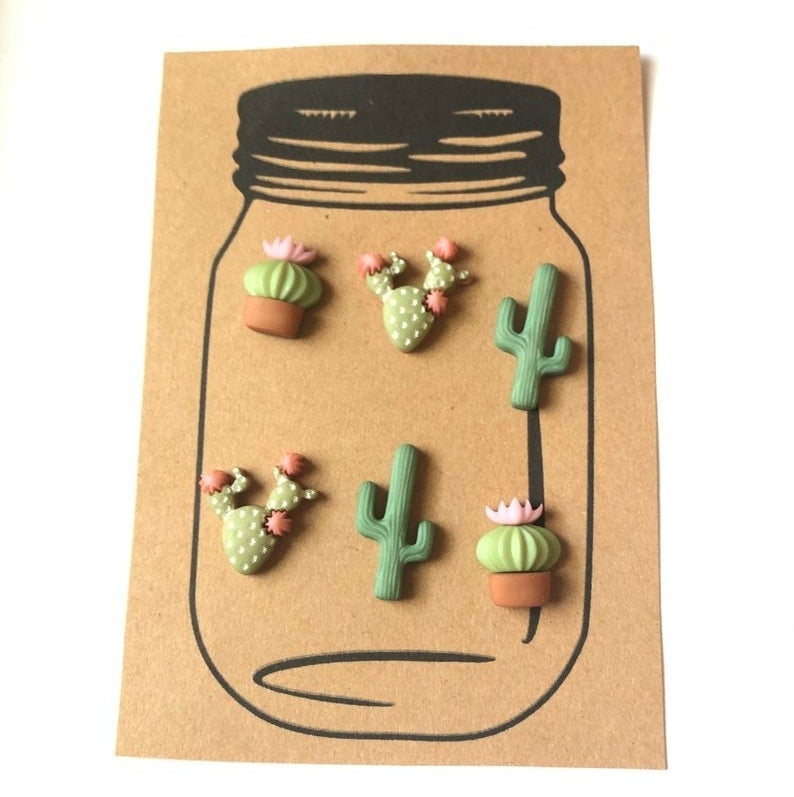 Six cactus and desert flower magnets about one inch in size