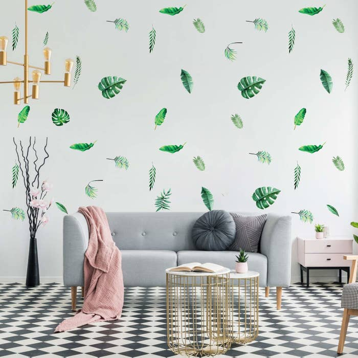 Leaf stickers covering a wall in sporadic locations