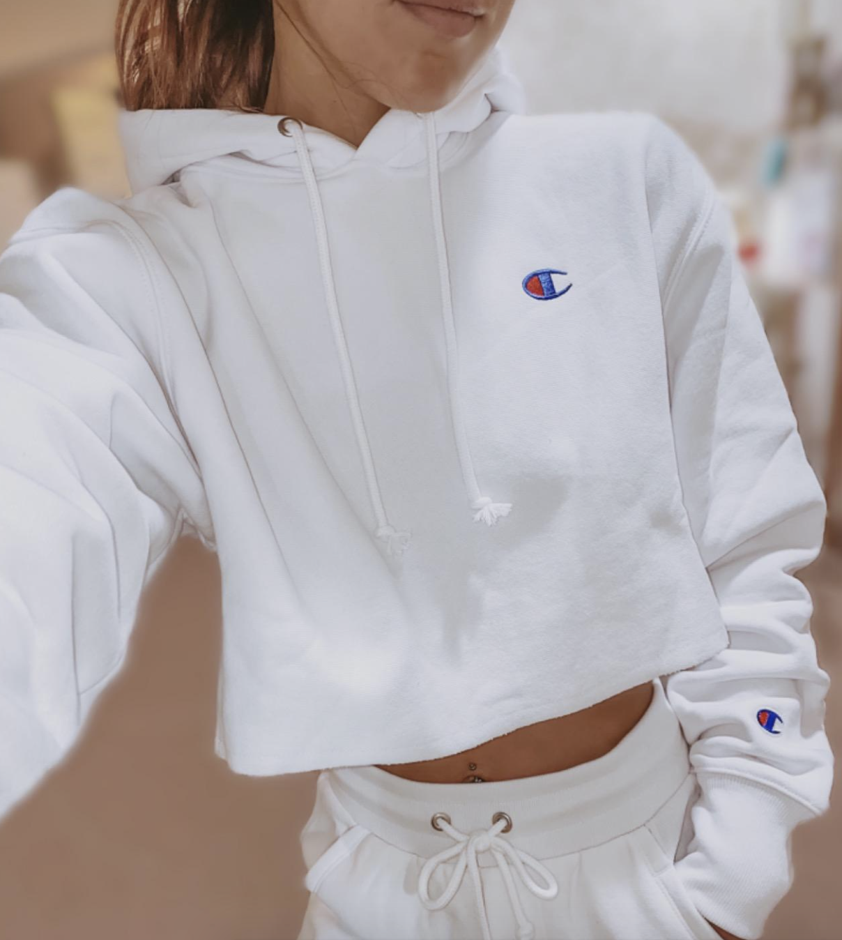 reviewer wearing white cropped hoodie