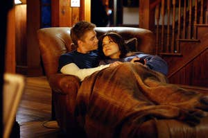 Brooke and Lucas cuddling in a chair together in Season 3