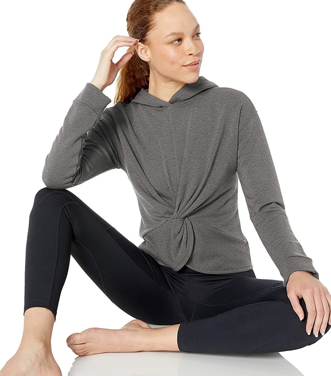 model wearing gray twist-front hoodie