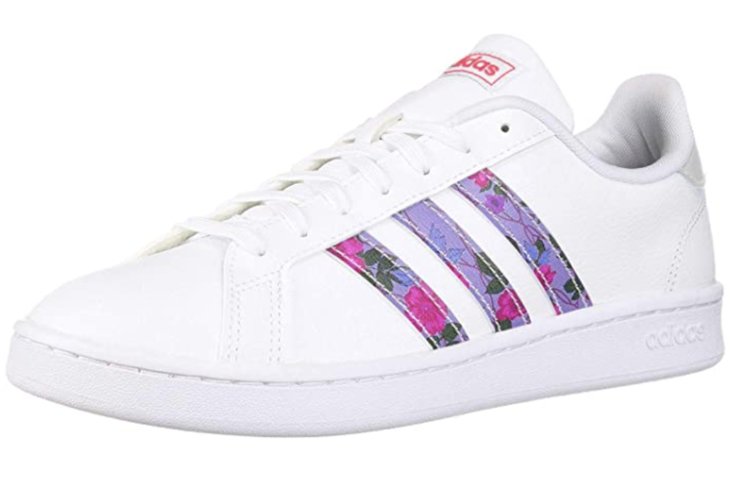 White Adidas court shoe with pink and purple floral stripes on the side
