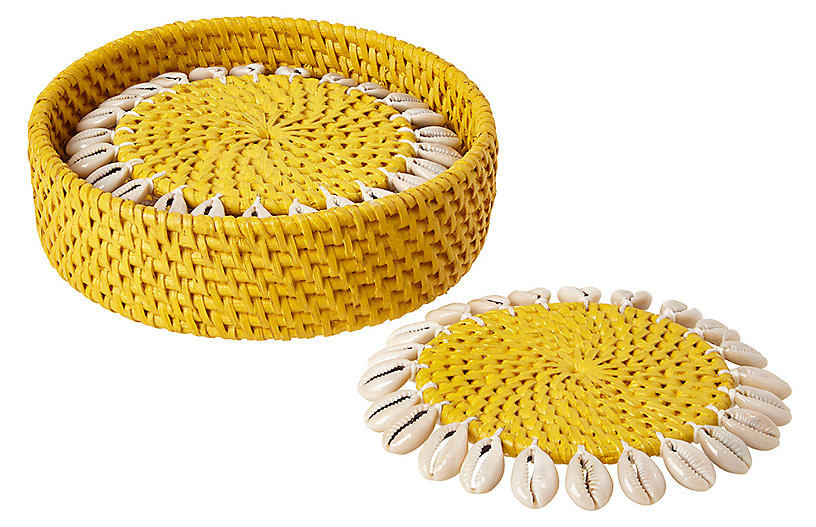 Bright woven coasters decorated with cowrie shells