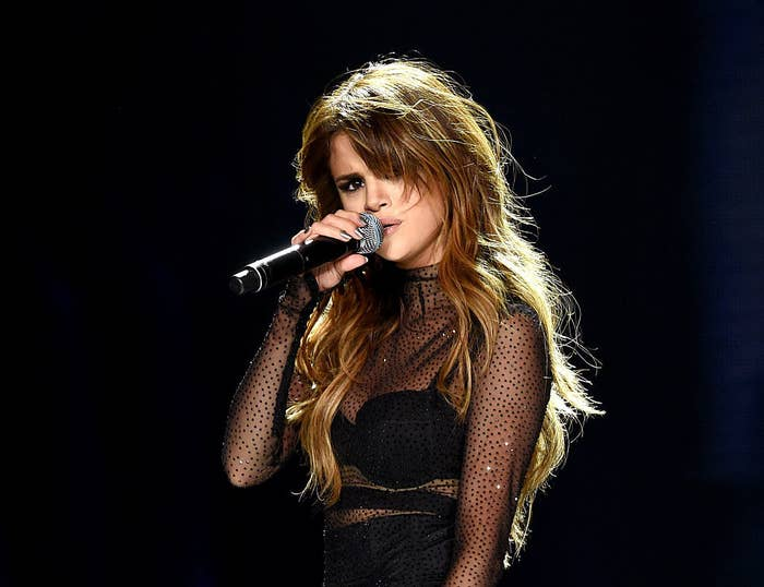 Selena singing into a microphone