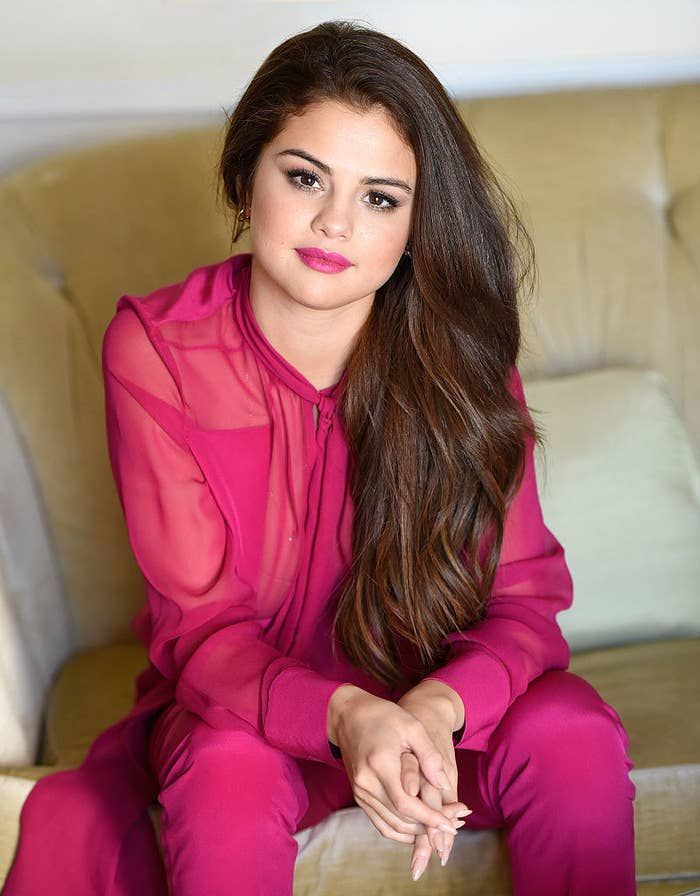 Selena wearing her hair long wavy hair