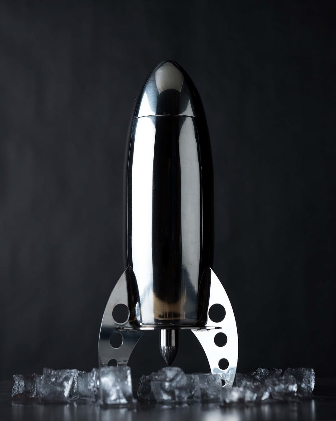 A close up of the rocket shaped shaker on a bed of ice