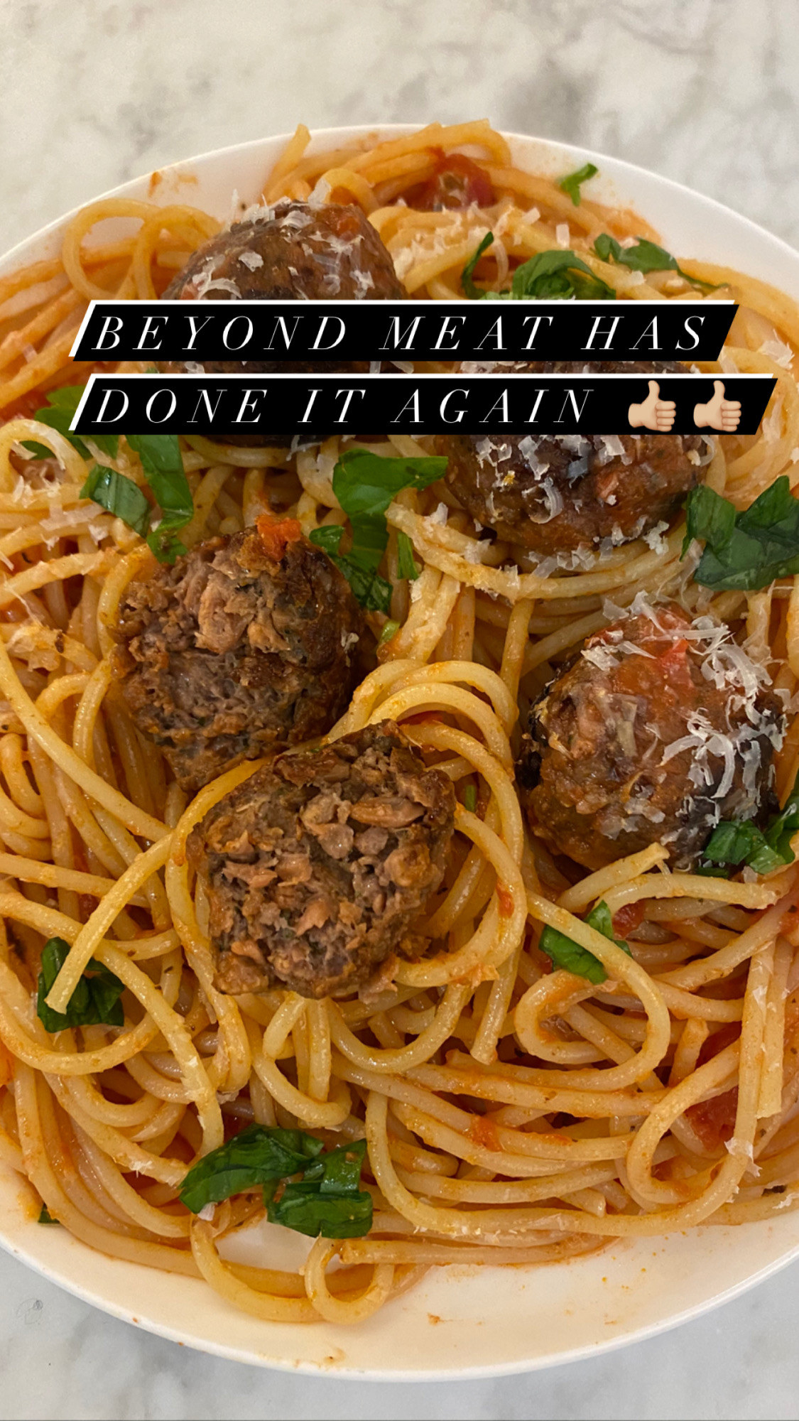 A plate of Beyond Meat meatballs over spaghetti.