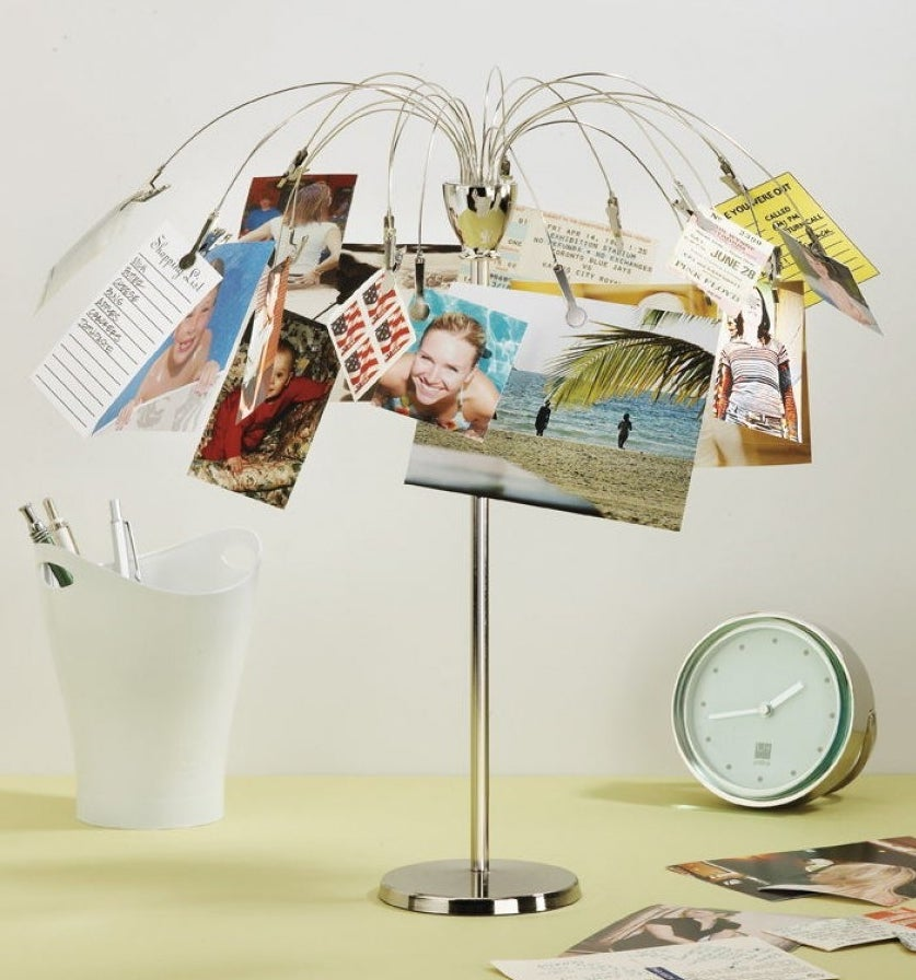 plated stainless steel picture holder with an umbrella shape that has clips to hold photos