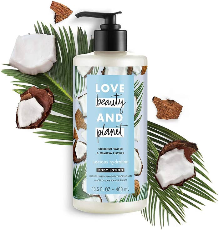 A body lotion  on a background with chunks of coconut and palm leaves