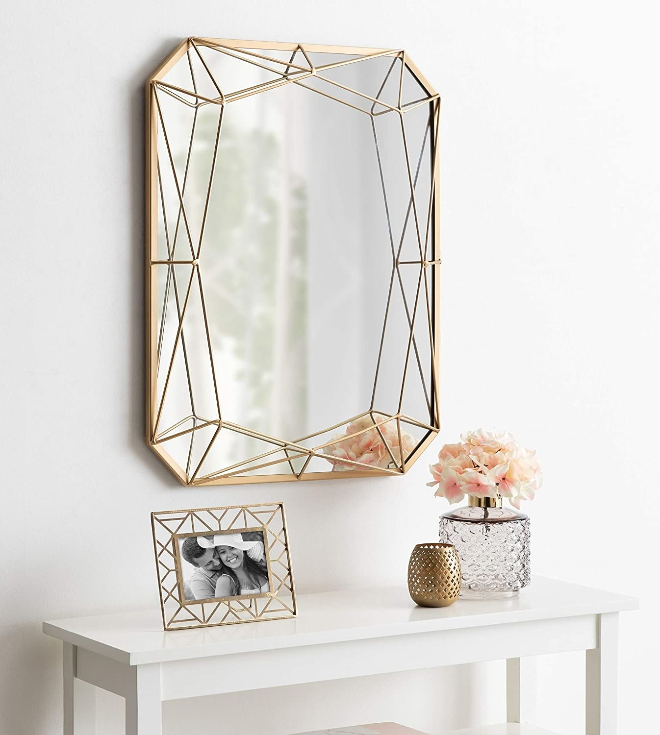 Large mirror with gold wire in geometric pattern on sides