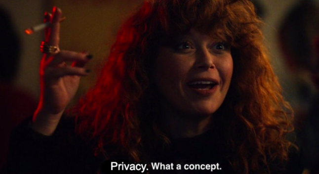 Natasha lyonne in russian doll smokes a cigarette