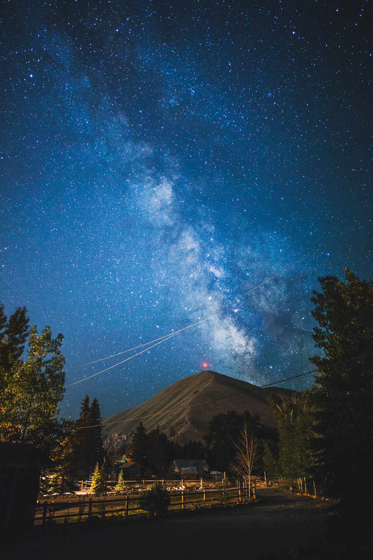 the milky way glistens in the night sky over Della Mountain in idaho