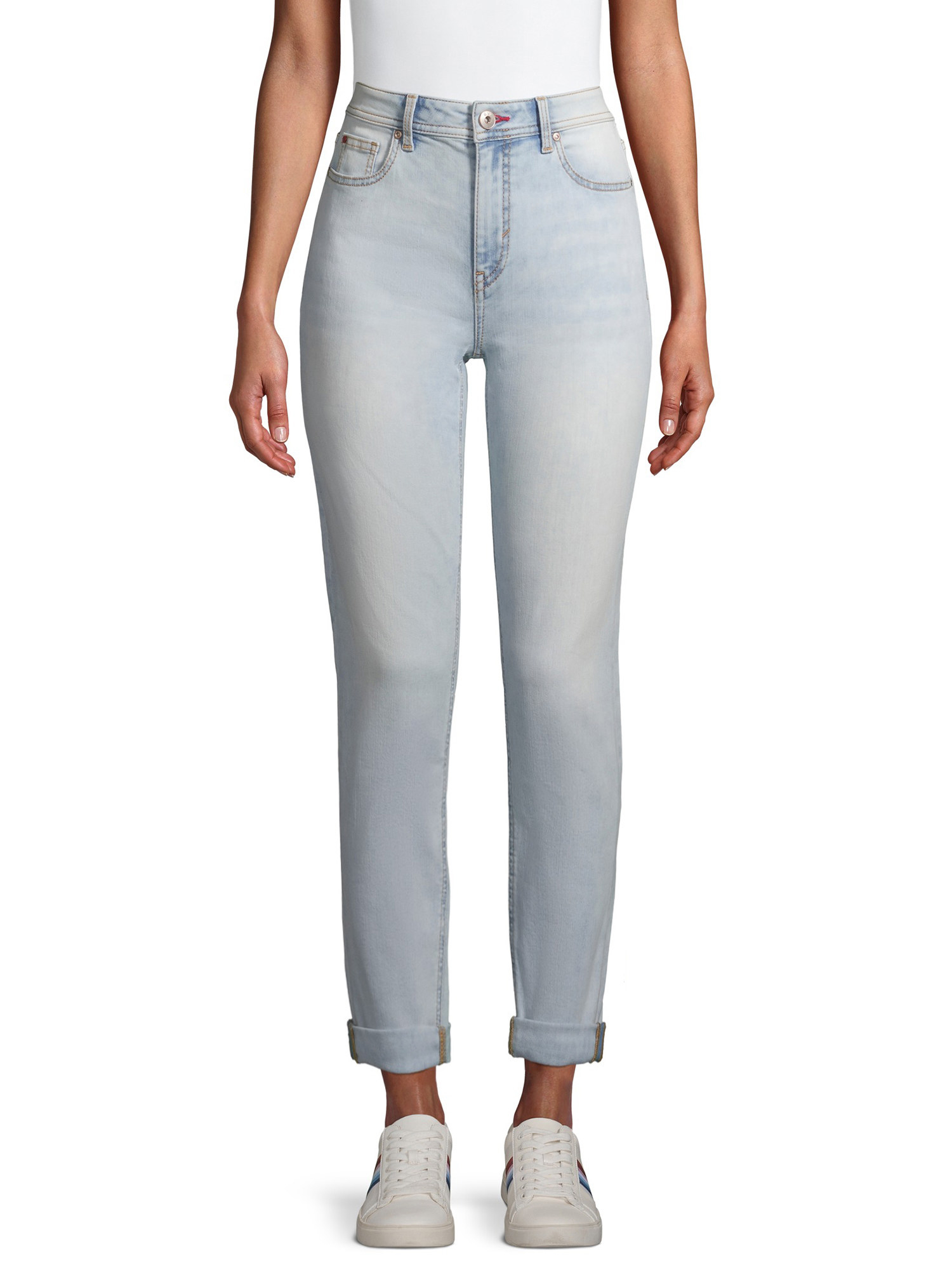 Model wearing a light wash pair of cuffed relaxed jeans