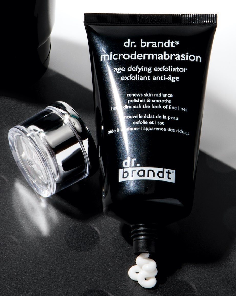 dr brant microdermabrasion product in black tube with some white product spilling out on to a countertop