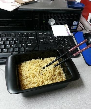 A reviewer's cooked noodles in the black square cooker bowl