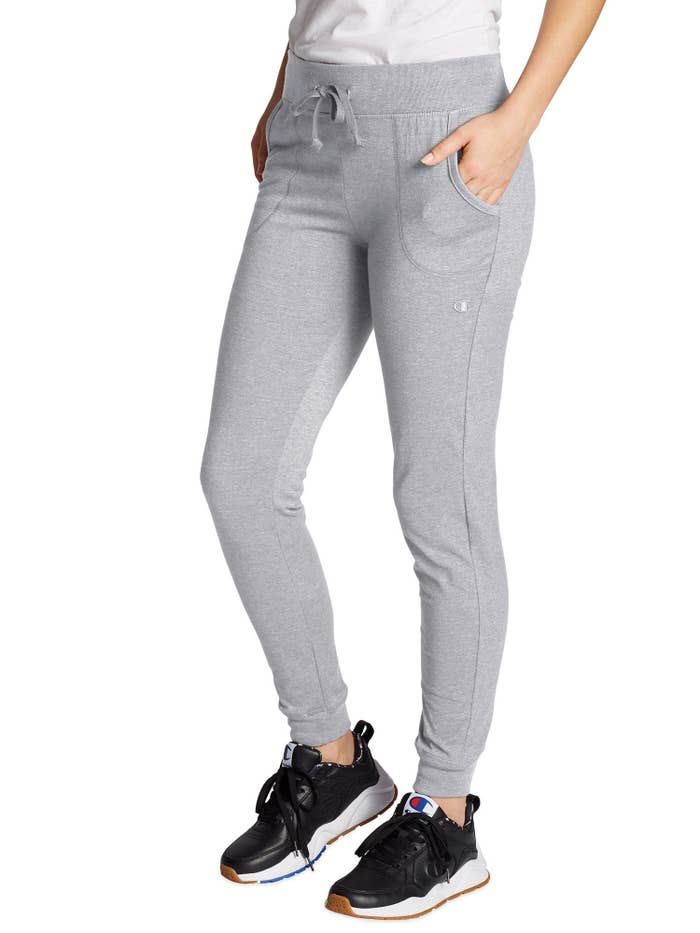 Model wearing gray joggers and black tennis shoes
