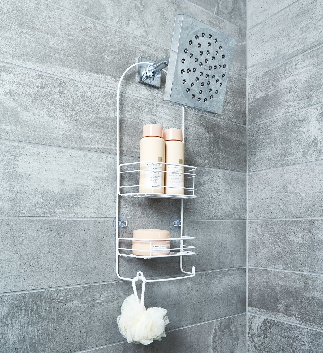 The shower caddy being used to hold shampoo, conditioner, and a loofa