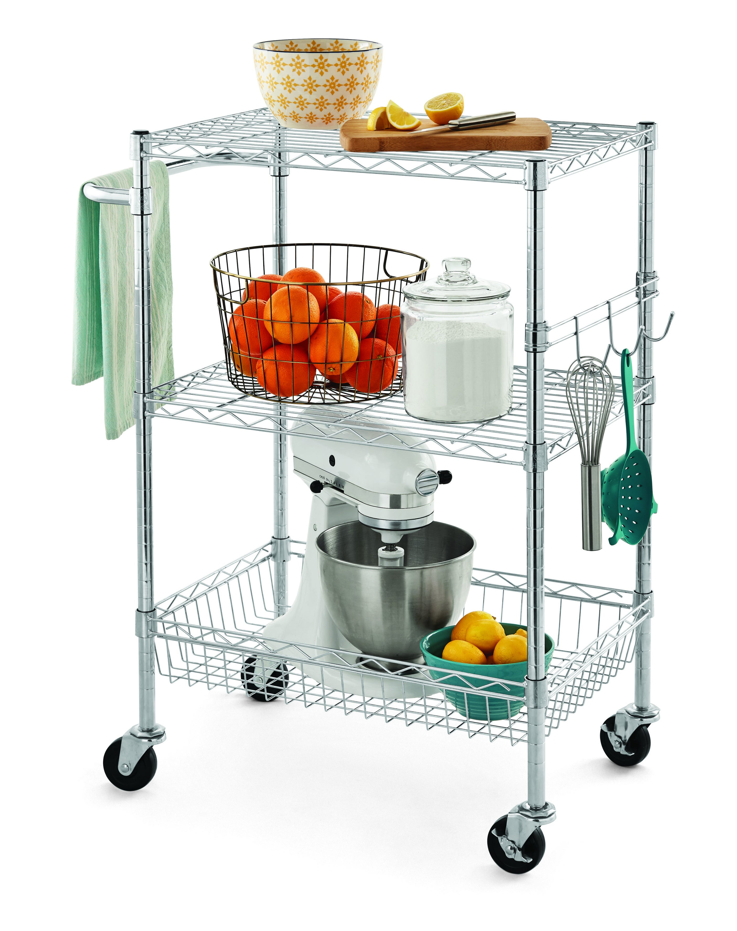 Steel rolling cart with kitchen tools on it