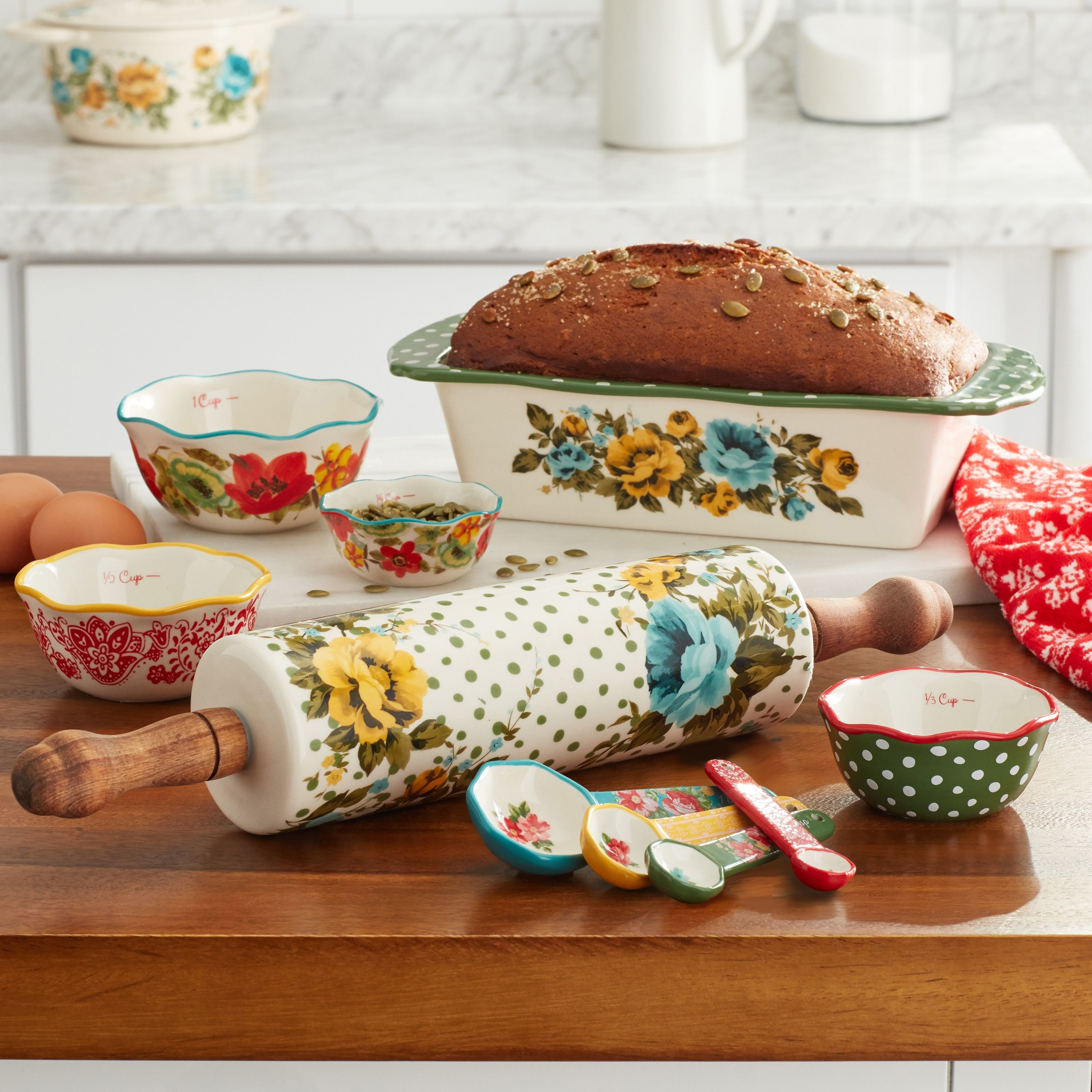 10 piece The Pioneer Woman bakeware set with floral pattern on a kitchen counter