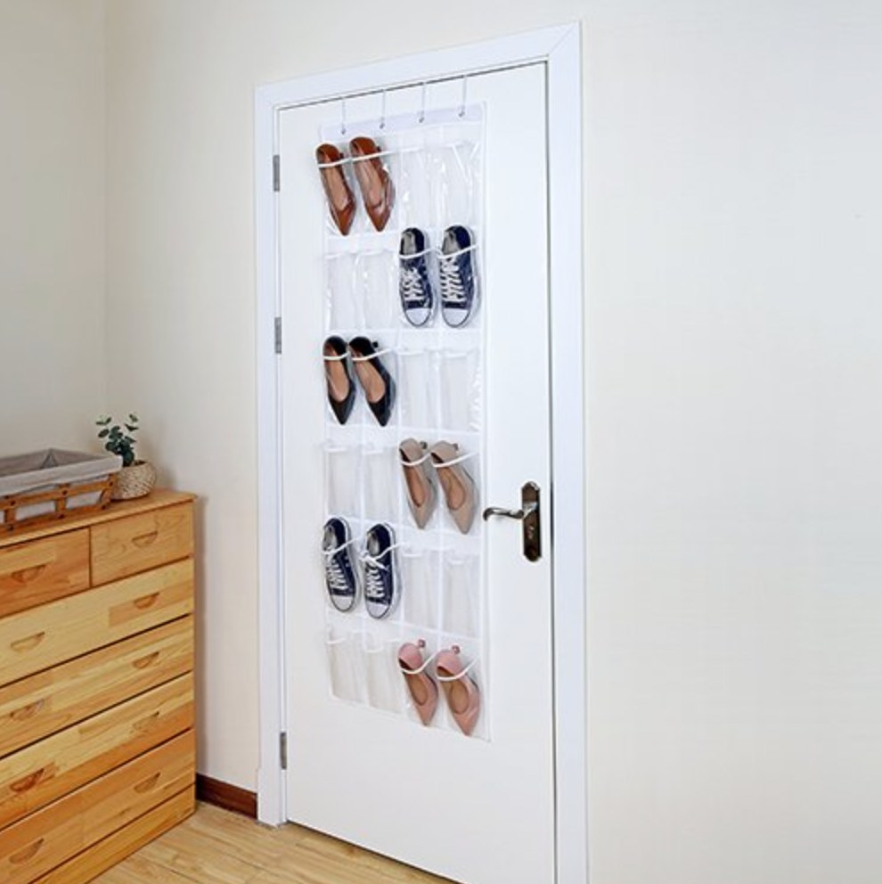 The over-the-door shoe holder being used to hold sneakers and heels
