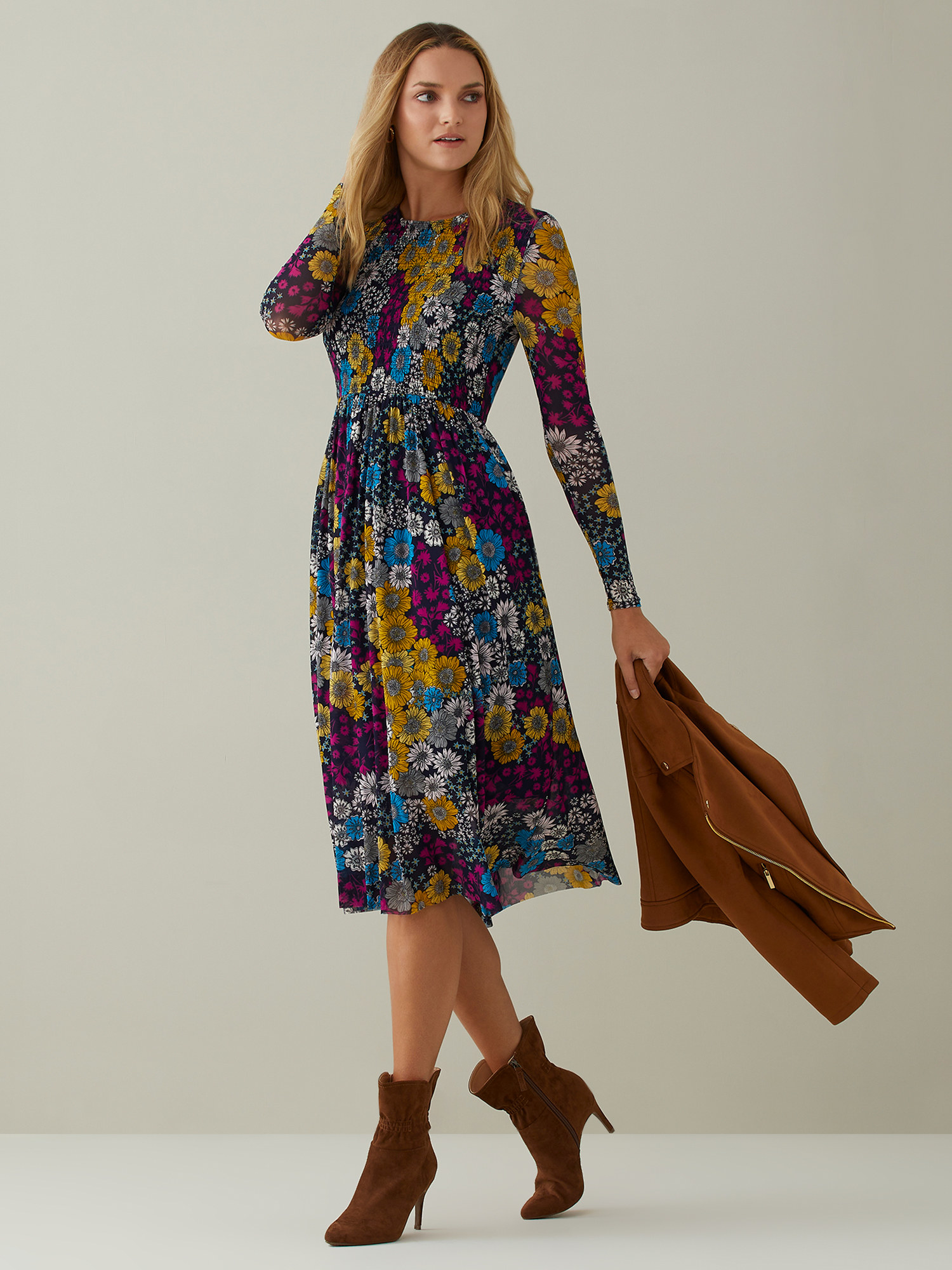 Model wears bright purple and blue floral dress