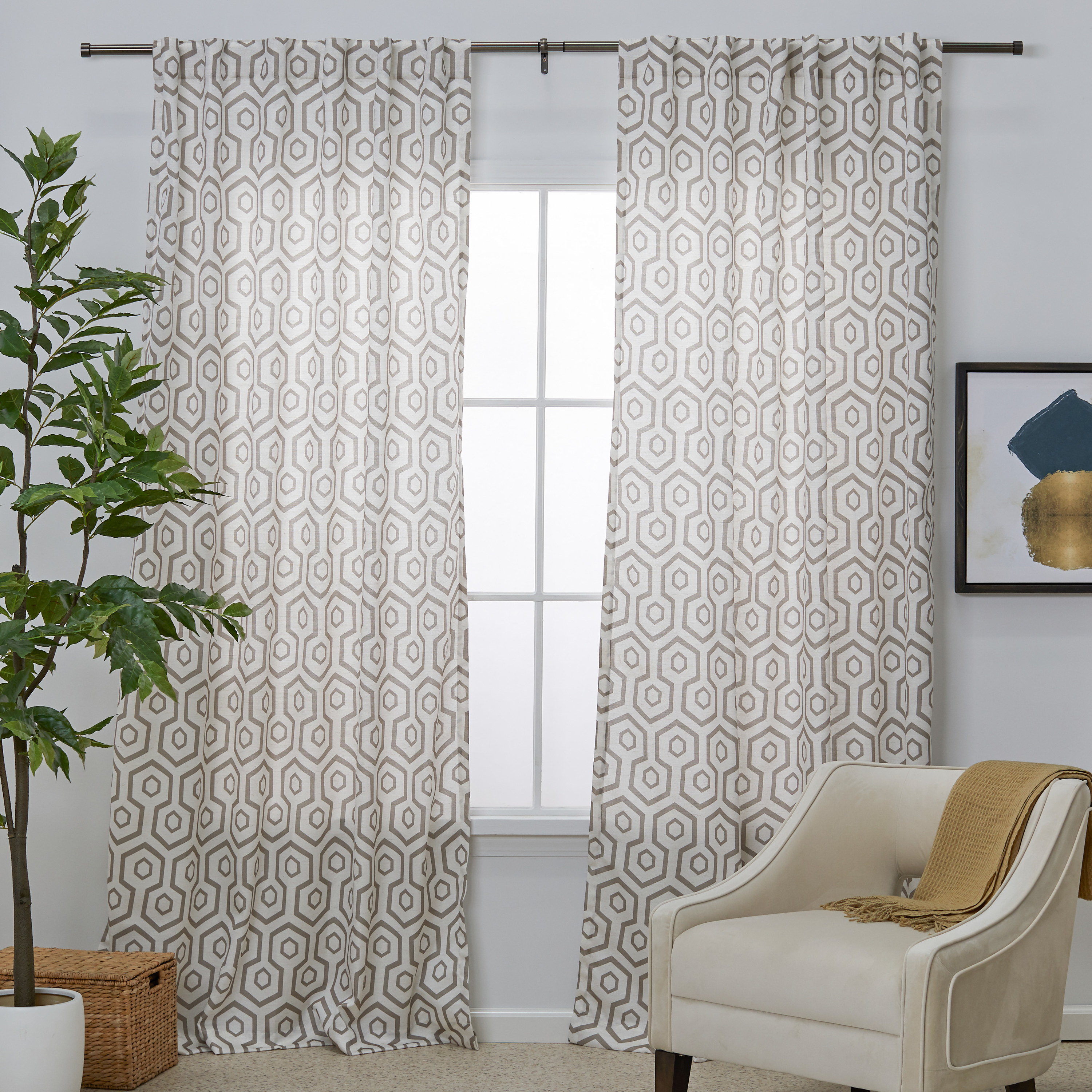 A natural-color geo print curtain panel pair over a window