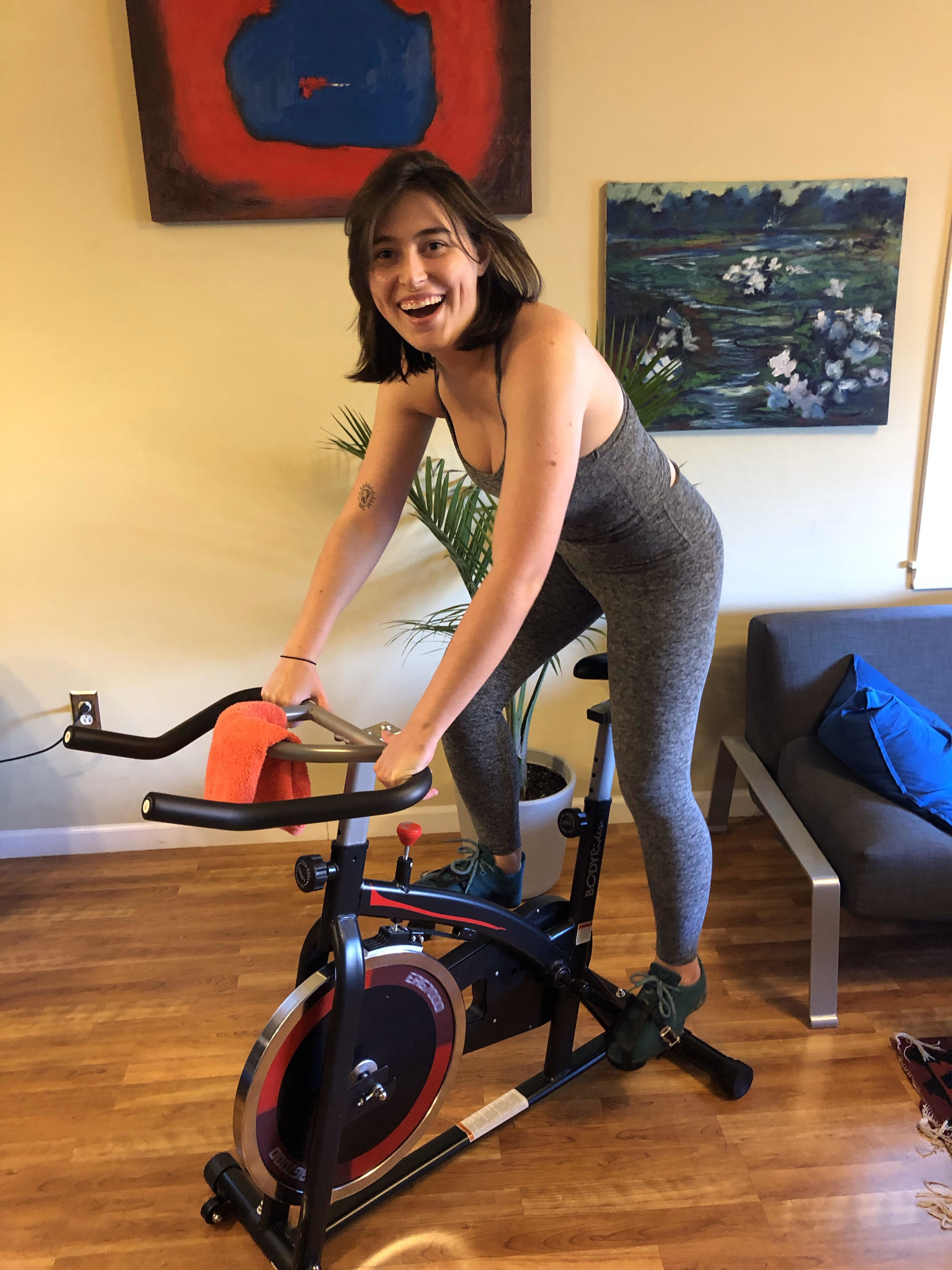the writer on a black and red stationary bike