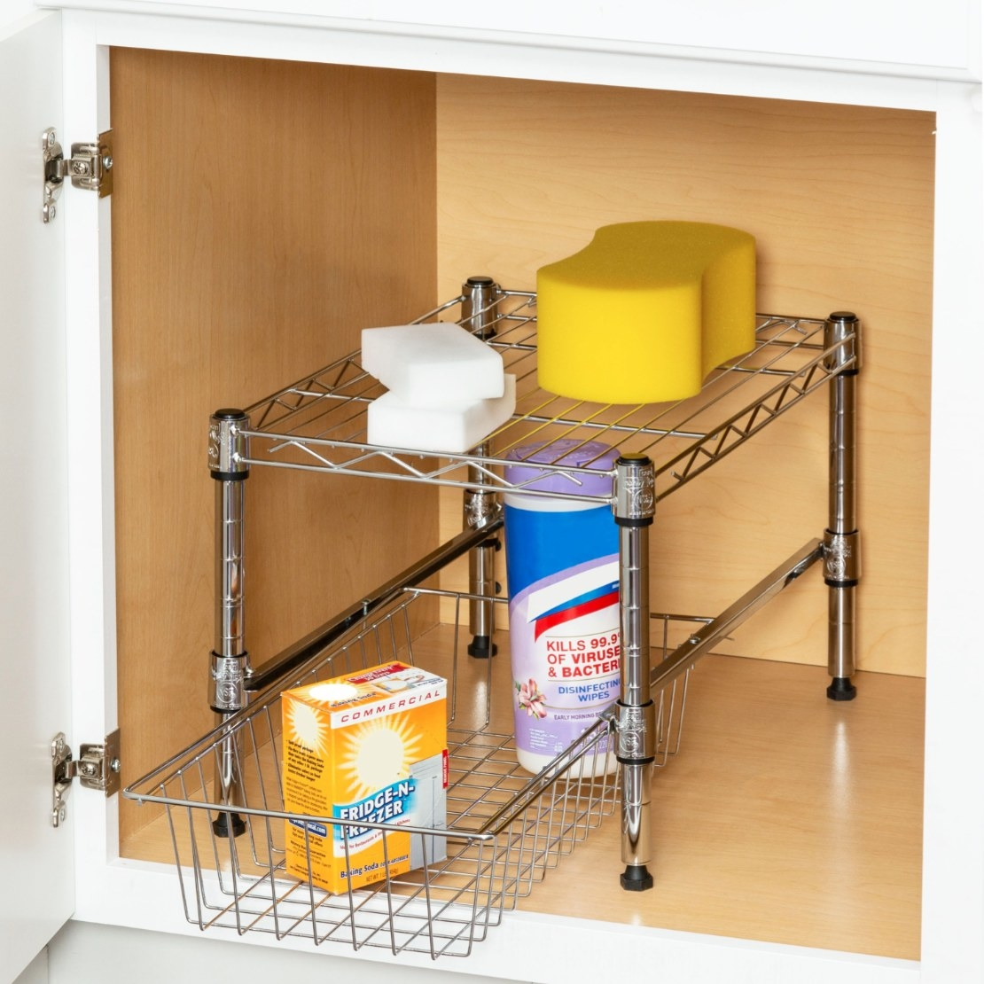 The under-the-cabinet storage item being used to hold cleaning products