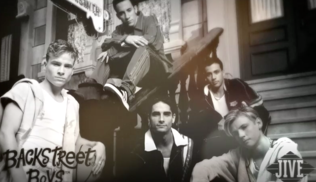 black and white photo of the backstreet boys with their logo in the lower left corner