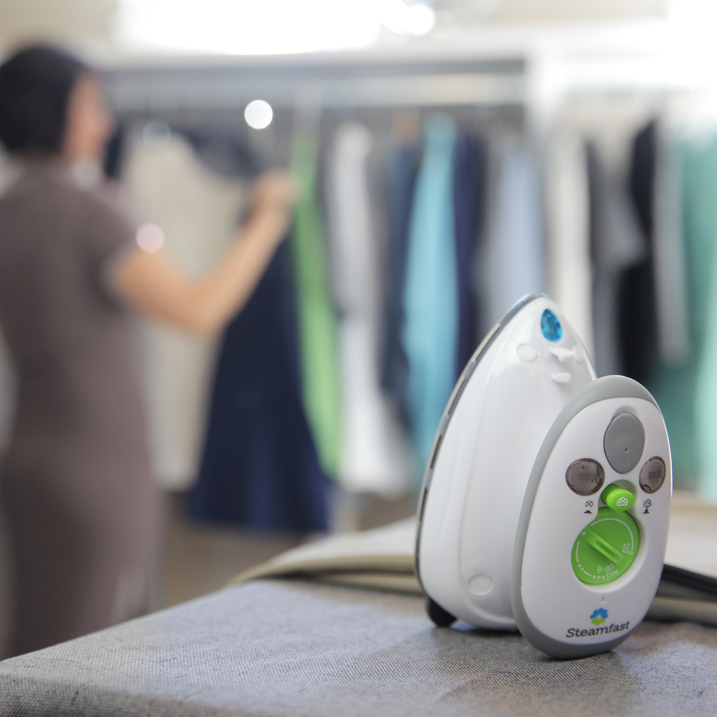 The mini steam iron on an ironing board