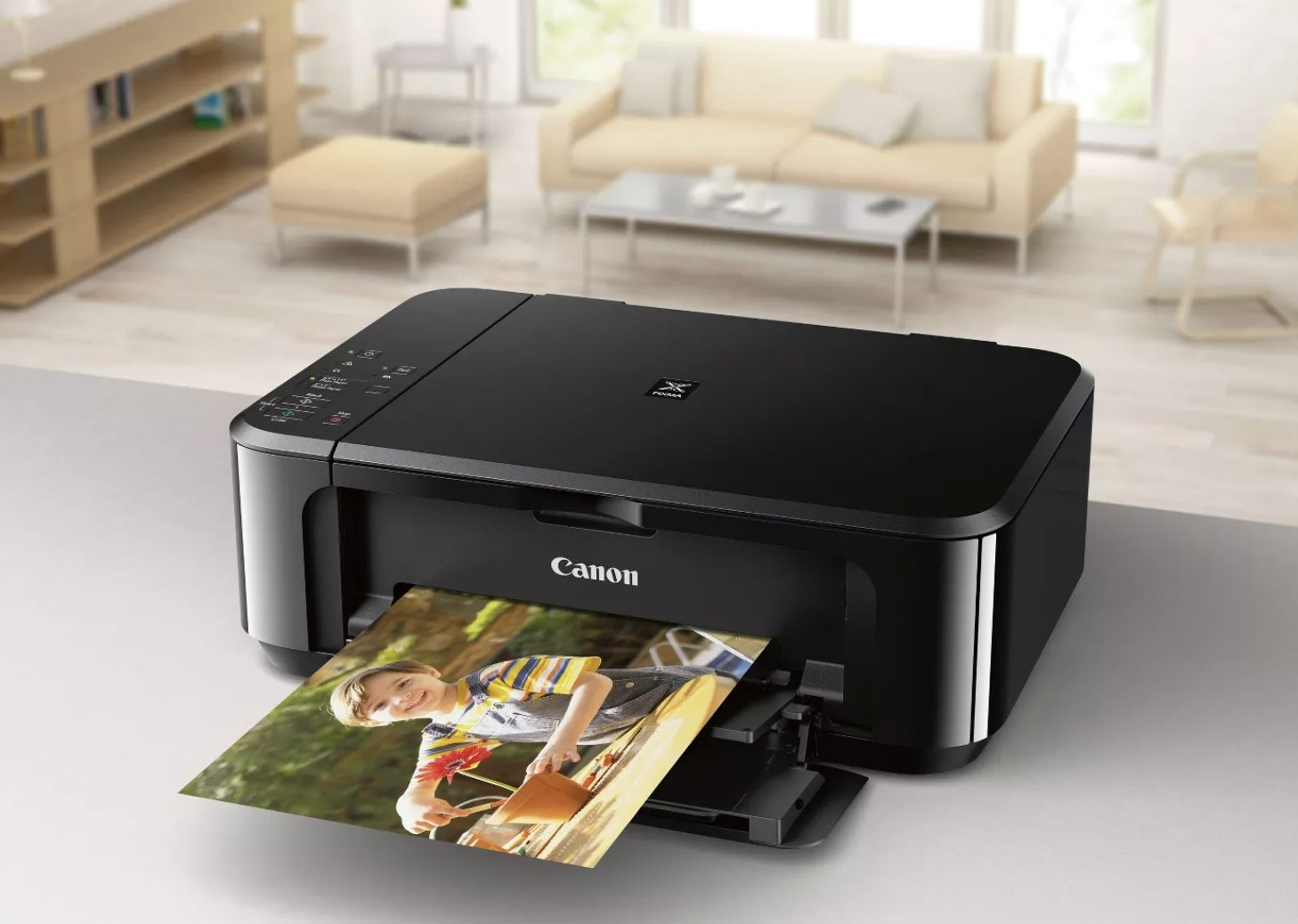 A black canon printer with a photo of a child being printed out